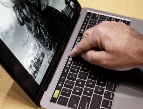 Bỏ phím Esc và fn, thay vào đó là các phím ảo hiển thị trên thanh cảm ứng Touch Bar - Ảnh: Business Insider